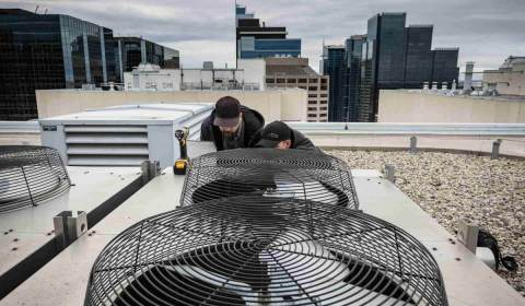 Air conditioning unit on rooftop in downtown Calgary-min