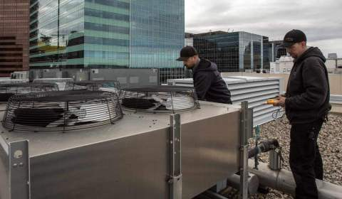 Servicing rooftop unit in downtown Calgary